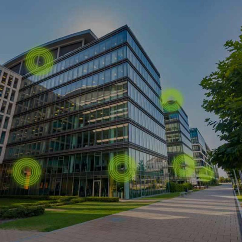 Office building with green circle graphics overlaid